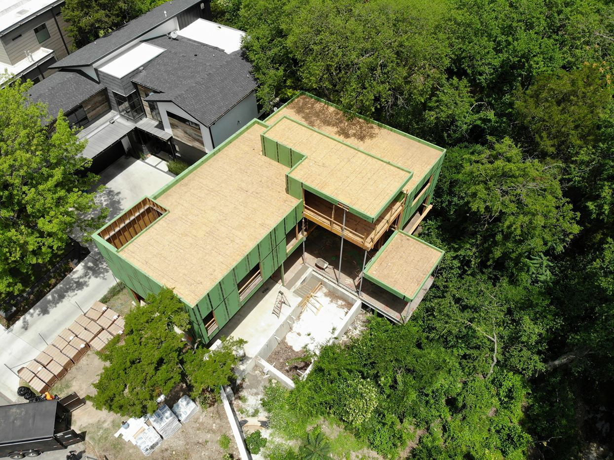 green tree house commercial roofing project Alliance Roofing & Construction