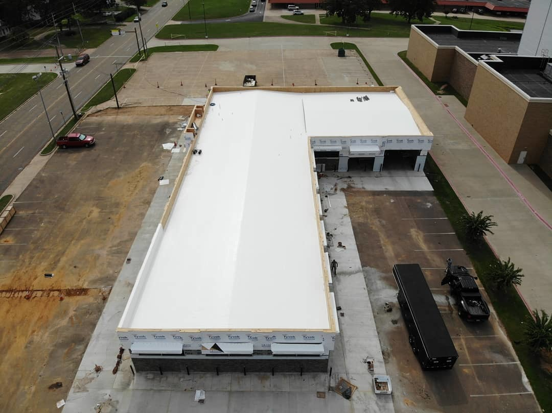 building with white roof Alliance Roofing & Construction