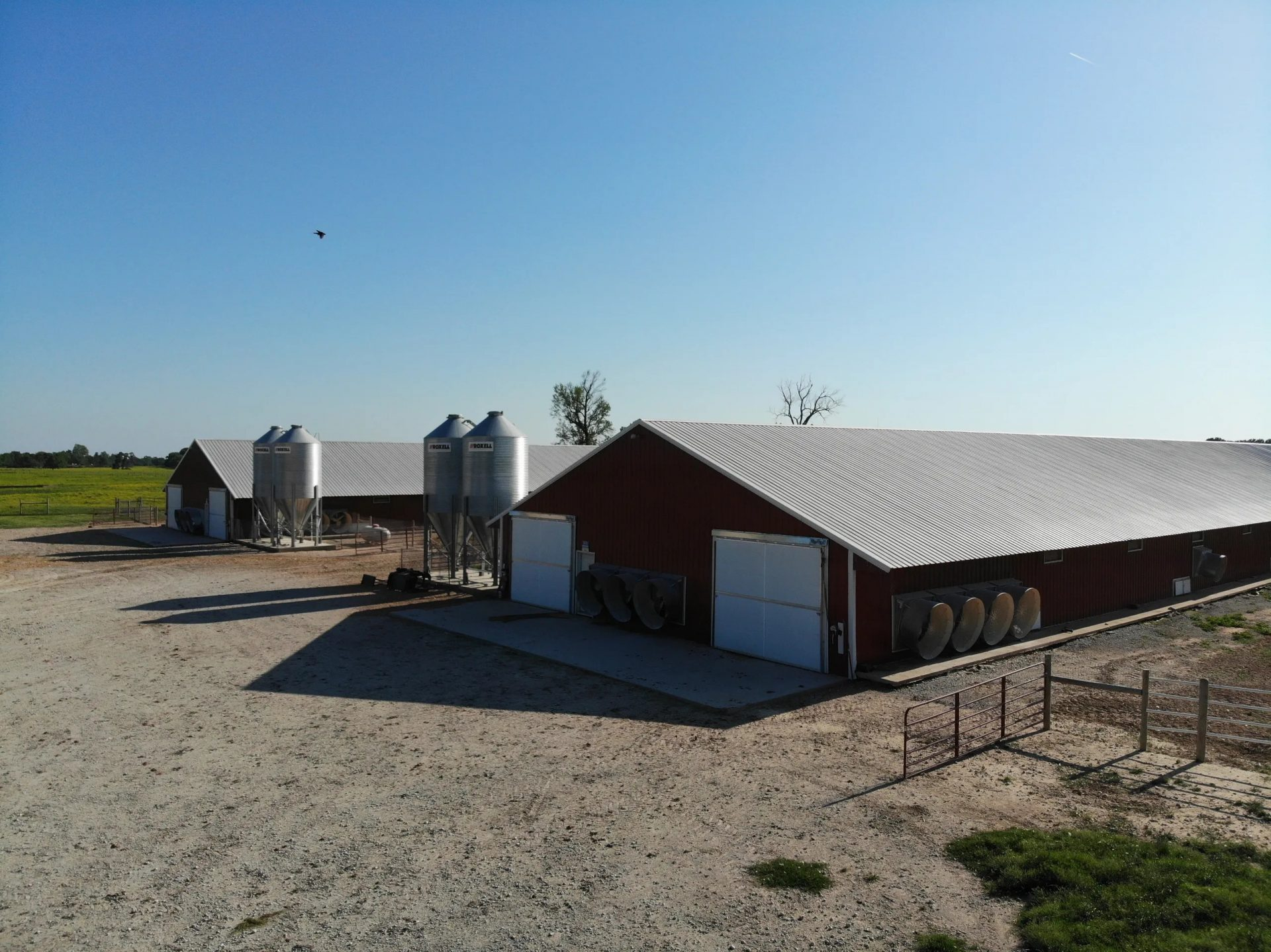 chicken farm with feed bins Alliance Roofing & Construction