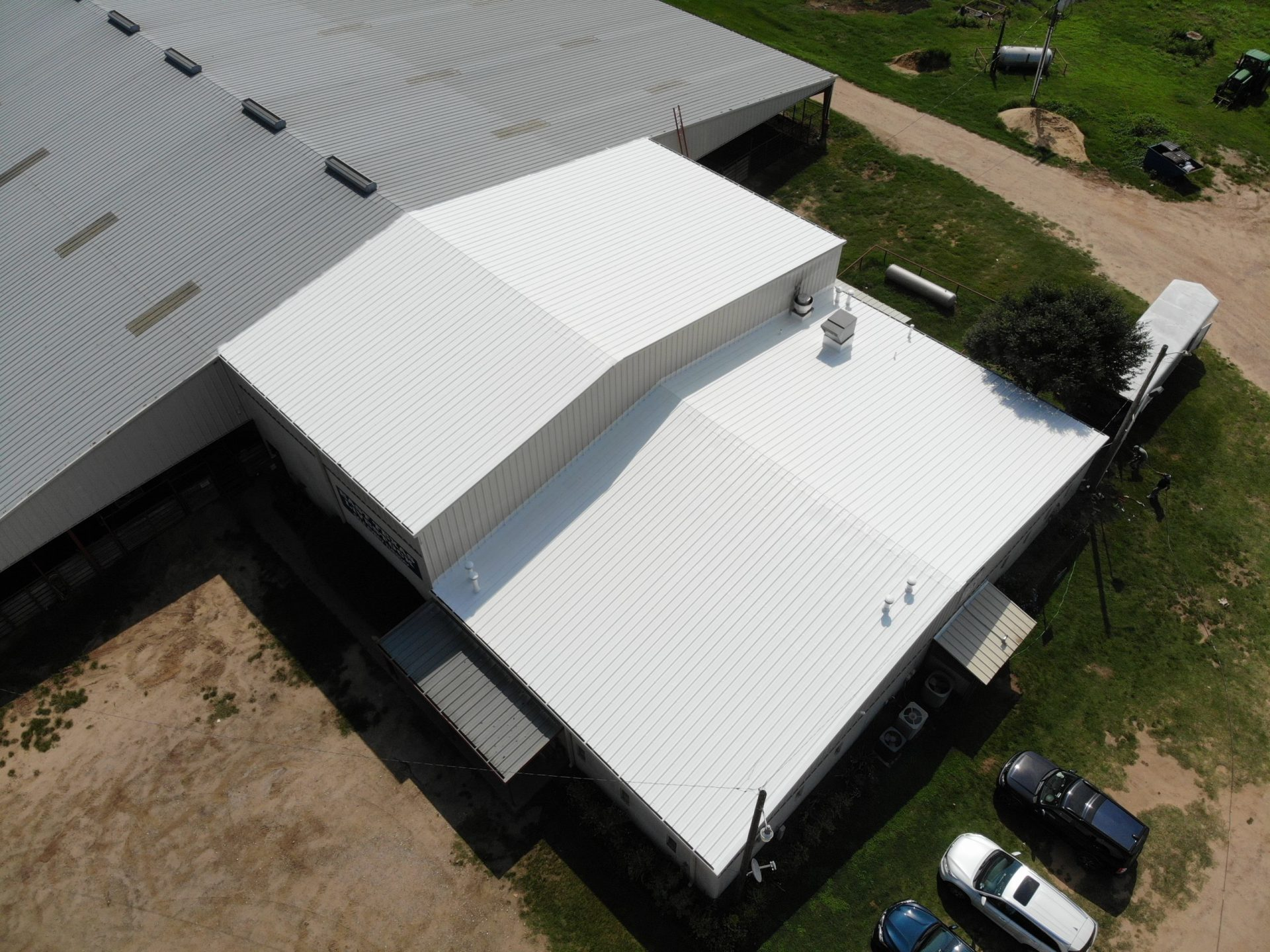 white coating metal restoration Alliance Roofing & Construction